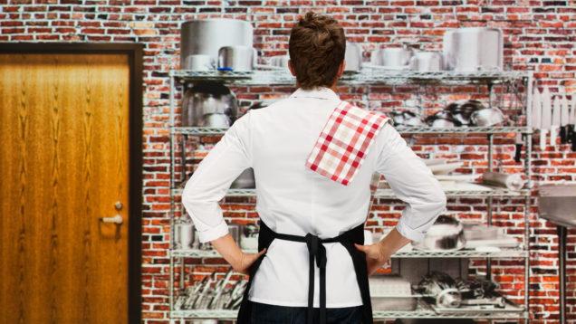 Rear view of baker standing in bakery